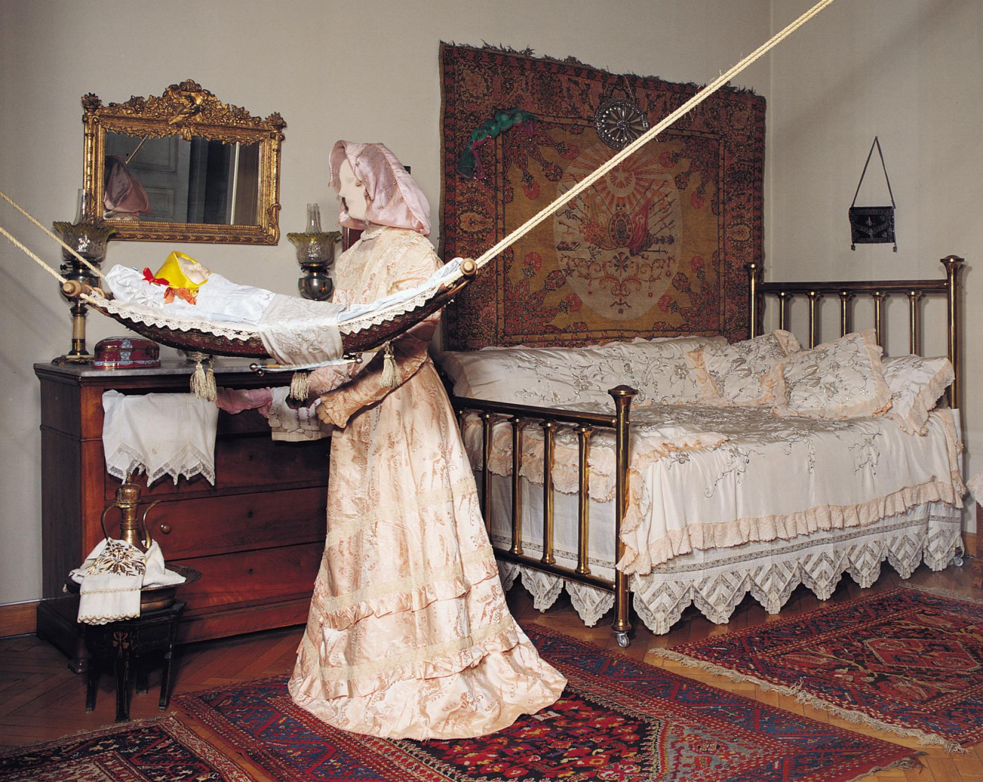 Childbed customs - The periods immediately before and after childbirth have a place of special importance in the customs of the Turks. A midwife living in the vicinity would be selected and angaged. In the most spacious bedroom of the newborn baby's house , the childbed was set up. The childbed was covered with a quilt of satin or velvet with matching pillows and cushions. After a birth, pitchers of a specially- prepared sherbet would be sent out to relatives, close family friends, and neighbors to announce the good news. The guests coming to offer their congratulations would be served sherbet. The childbed would be dismantled on the seventh day of confinement. The fortied day after the birth of a child was the occasion for the mother  and infant's excursion to the local public bath accompanied by friends, neighbors, and relatives.
