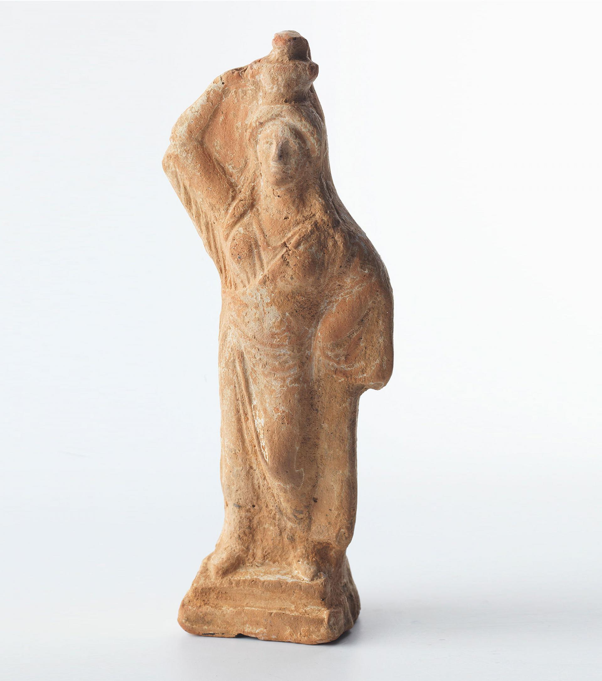 SHM 7274 - Figurine of a standing womanTerracotta Classical Period5th-4th century BC